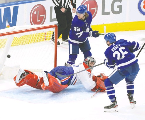 ?? DAN HAMILTON / USA TODAY SPORTS ?? Toronto Maple Leafs winger Jimmy Vesey scores the tying goal past Montreal's Carey Price in the third period on Wednesday in Toronto. The age-old rivals will have plenty of time to get to know each other better this season.