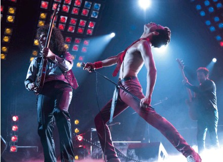 ??  ?? The film's power comes mainly from the tunes and from Mercury/Malek's magnificent stage presence.