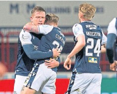 ??  ?? Dundee celebrate the winner in the recent Pars clash.