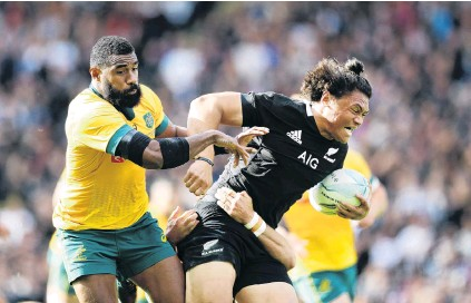 ?? PHOTO: GETTY IM­AGES ?? Putting the ham­mer down . . . All Black wing Caleb Clarke charges past Wal­laby coun­ter­part Marika Koroi­bete in the sec­ond Bledis­loe Cup test in Auck­land yes­ter­day.