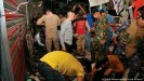 ??  ?? Security forces comb through wreckage in Wahailat market, Sadr City