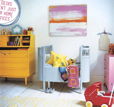 ??  ?? INSTEAD OF A CONVENTIONAL CHEST of drawers, reclaim an old desk and paint it a vibrant color. The beautiful Danish vintage wooden toddler bed is dressed in vintage-fabric cushions and patchwork and wool blankets.
