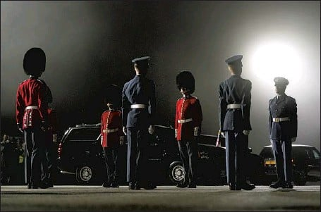 ?? Patrick Semansky Associated Press ?? AN HONOR guard stands on a foggy tarmac before President Biden and Jill Biden step off Air Force One at Cornwall Airport Newquay.