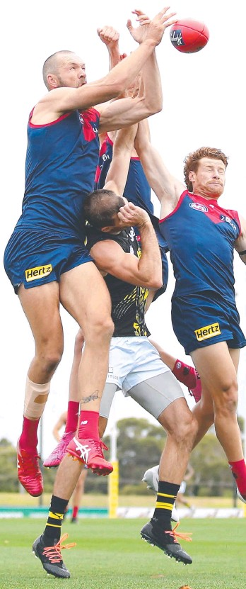 ??  ?? Demons star Max Gawn looks to mark in a practice match against Richmond.