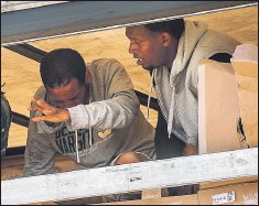 ??  ?? Migrants caught hiding in a truck in Calais last summer