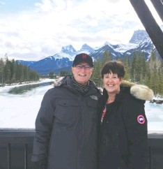 ?? THE GREERS ?? John and Paula Greer show off the stunning views from their new home in Spring Creek, Canmore.