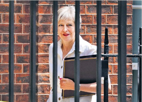 ??  ?? Theresa May leaves Downing Street for Parliament, where she avoided a narrow defeat on Brexit – but she could yet face a vote of no confidence