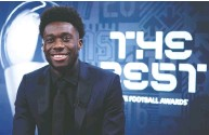 ?? MARCO DONATO / FC BAYERN / GETTY IMAGES ?? Rising Canadian star Alphonso Davies, seen during December's online broadcast of the FIFA The Best Awards, won five titles with Bayern Munich this past year.
