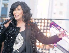 ??  ?? Cher, performing on NBC's show, is among those donating their voice to charity.