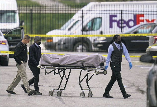 ?? Michael Conroy/the Associated Press ?? A former Fedex worker returned to his old workplace Thursday night and killed eight people and wounded several more before taking his own life, police said. The attack was the latest in a string of recent mass shootings across the country and the third mass shooting this year in Indianapolis.