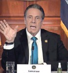 ?? AP ?? New York Gov. Andrew Cuomo defends a decision to require nursing homes to accept patients recovering from COVID-19 during a news conference Feb. 19.
