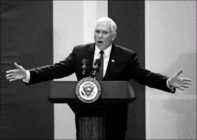 """?? Nathan Hunsinger/Staff Photographer ?? Vice President Mike Pence, speaking at the Dallas County Republican Party's Reagan Day dinner Saturday night, said, """"We're going to secure our border. We're going to fix this broken immigration system and, make no mistake about it, we're going to build..."""