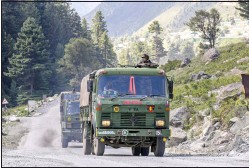 ??  ?? An Indian army convoy moves on the Srinagar- Ladakh highway at Gagangeer, northeast of Srinagar, Indian-controlled Kashmir, Wednesday, September 9.