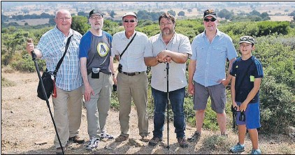 ?? FRANK GOGOS/SPECIAL TO THE TELEGRAM ?? Caribou Hill–Suvla Plain in the background. From left are members of a Newfoundland and Labrador delegation to mark the 100th anniversary of the First World War: Ken Gatehouse, Ean Parsons, Keven Regan, Frank Gogos, Neil Burgess and Nico Sherren.