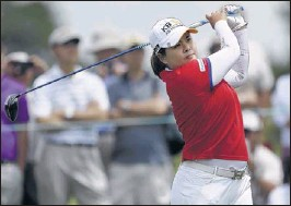 ?? FRANK FRANKLIN II/ASSOCIATED PRESS ?? Inbee Park is on the brink of history at the U. S. Women's Open at Southampton, N.Y. In the lead after three rounds, she could become the first woman to win the first three majors of the year.