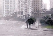 ?? WILFREDO LEE/ASSOCIATED PRESS ?? Waves pound a seawall in Biscayne Bay, Fla., on Sept. 10. Defying any threats from weather, coastal counties' population growth has been above average for decades.