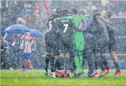 ?? AFP ?? Real Madrid players celebrate their qualification for the Champions League final at the Vicente Calderon stadium in Madrid.