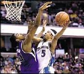 1054d920d24c Mid-air tussle Washington Wizards  Dominic McGuire shoots against  Sacramento Kings  Jason Thomson on Sunday.