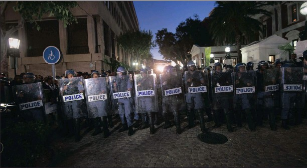 ??  ?? MOVING IN: Riot police move through the parliamentary precinct during the State of the Nation Address by President Jacob Zuma. More than 400 soldiers were also deployed, outraging opposition parties.