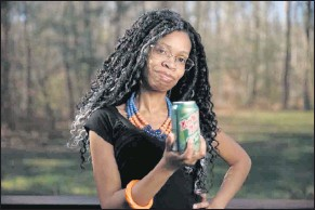 ?? MIKE MORONES / THE FREE LANCE–STAR ?? Stephanie Johnson holds a can of Northern Neck Ginger Ale fromher dwindling supply. The King George County residentwants to persuade Coca-Cola to revive her favorite drink.