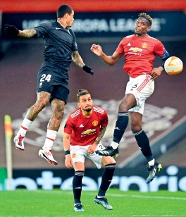 ?? AFP ?? Manchester United's Alex Telles looks on as his teammate Paul Pogba (right) vies with Granada's Kenedy (left) during their UEFA Europa League quarterfinal second leg match at Old Trafford stadium in Manchester on Thursday. —