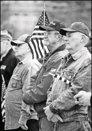 ?? CHRISTOPHER DOLAN / STAFF PHOTOGRAPHER ?? Veteran Ed Chomko Sr. of Scranton, center, holds a flag Monday during the annual Koch-conley American Legion Post Veterans Day Program on Courthouse Square in Scranton. Chomko served two tours in Vietnam as an Army Ranger.