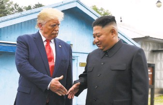 ?? Susan Walsh / Associated Press 2019 ?? Former President Donald Trump meets with North Korean leader Kim Jong Un in the border village of Panmunjom in the Demilitarized Zone with South Korea in June 2019.