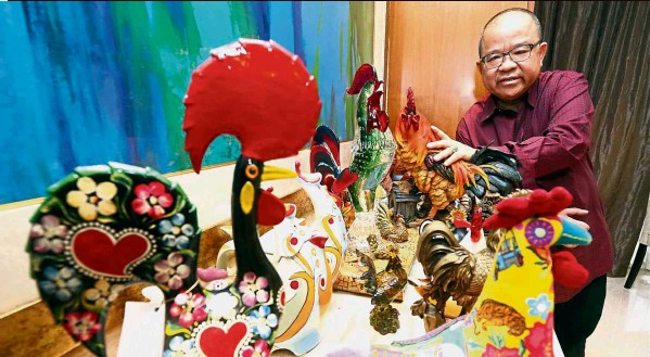 ??  ?? Avid collector: Francis showing his chicken figurine collection at his Ampang Hilir home.