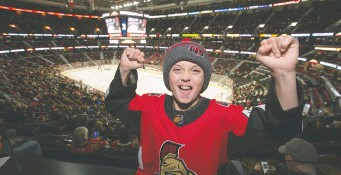 ?? WAYNE CUDDINGTON ?? Zander Zatylny was honoured for his work with CHEO at Saturday's Senators game at Canadian Tire Centre, scoring a trip to Boston next March to see Ottawa's NHL team take on the Bruins.
