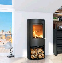 ??  ?? Right: The TT21R wood burner from Termatech (www. termatech.com) has an elliptical design and an operating range of 3kw-7kw