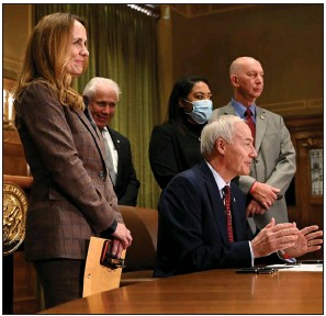 ?? (Arkansas Democrat-Gazette/Stephen Swofford) ?? Gov. Asa Hutchinson, joined by Arkansas lawmakers and teachers, holds a news conference Monday at the state Capitol in Little Rock to sign the two measures to increase the state's median teacher salary.