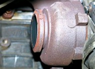 ??  ?? Pictured is the point at which the turbocharger and exhaust system mate. Check that the flange is in good condition and consider giving it a clean with a wire brush, but take care that no particles enter the housing.