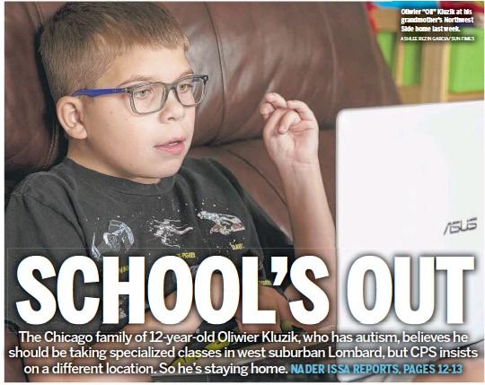 "?? ASHLEE REZIN GARCIA/SUN-TIMES ?? Oliwier ""Oli"" Kluzik at his grandmother's Northwest Side home last week."