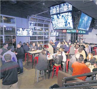 ?? Photos by Ron Baselice/Staff Photographer ?? Varsity Tavern is a massive venue that's part sports bar, with plenty of big flat-screen TVs, and part upscale lounge.