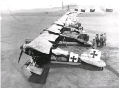 ??  ?? ■ Probably the most famous aircraft line-up photo of all time. Machines of Jasta 11 and Jasta 4 at Roucourt. Much debate continues as to whose machines are visible, but it is certain that second from the front is Manfred von Richthofen's all-red Albatros D.III: 'Le Petit Rouge'.