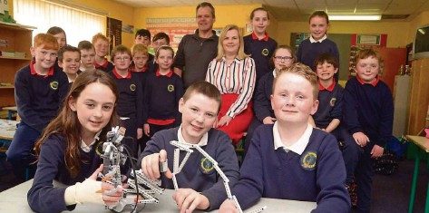 ?? Picture: Denis Boyle ?? At Togher NS, Dunmanway was Kimi Bosma, Oisín O'Brien and Thomas Kingston with their robots with teacher Richard Swan and principal Helen O'Connell.
