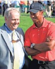 """?? 2012 PHOTO BY TONY DEJAK, AP ?? """"He really misses playing,"""" Jack Nicklaus, left, said about injured Tiger Woods, right."""