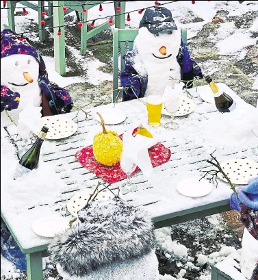 ??  ?? Andrew and Diane Ward, who run the Chequers on the Green in High Halden, made these brilliant snowmen at the front of their pub