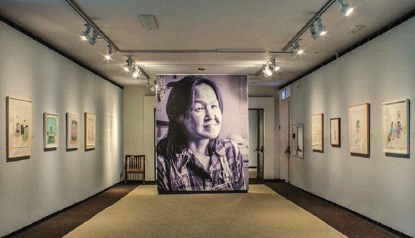 ?? PHOTOS COURTESY OF MCMICHAEL COLLECTION ?? A towering portrait of the late Annie Pootoogook greets viewers at the entry of Cutting Ice, an inadvertent commemorative exhibition of the revered Inuit artist's work.
