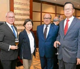 ??  ?? KPMG RGM&Co. vice chair and chief operating officer Emmanuel P. Bonoan (left), Banco de Oro chair Teresita Sy-Coson, HSBC president and CEO Jose Arnulfo A. Veloso and KPMG RGM&Co. chair and CEO Roberto G. Manabat