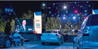 ?? CAROLYN KASTER/AP ?? Demo­cratic pres­i­den­tial can­di­date for­mer Vice Pres­i­dent Joe Bi­den par­tic­i­pates in a CNN drive-in town hall Thurs­day mod­er­ated by An­der­son Cooper in Moosic, Penn­syl­va­nia.