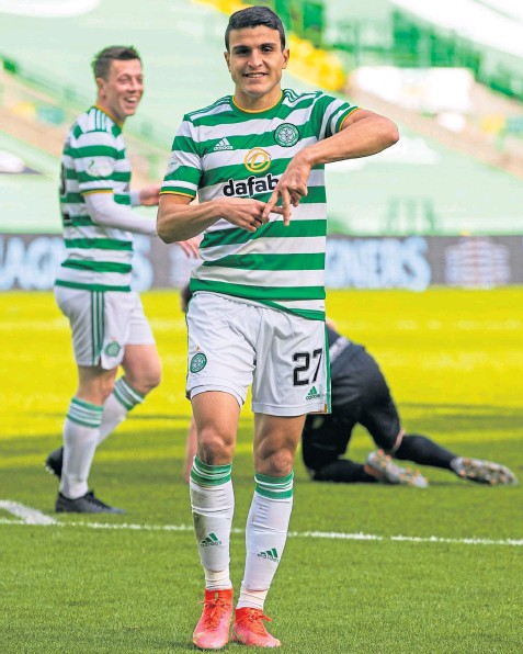??  ?? Two-goal Moi Elyounoussi celebrates the first of his strikes against Livingston at Celtic Park
