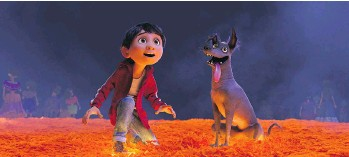 ?? PIXAR/DISNEY/ VIA THE ASSOCIATED PRESS ?? Miguel, voiced by Anthony Gonzalez, and his dog Dante travel to the Land of the Dead in Coco, a new Pixar animated movie based on Dia de Muertos. It hits theatres next month.
