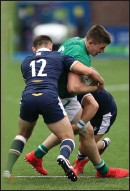 ??  ?? Scotland's Elliot Gourlay tackles Harry Sheridan