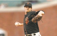 ?? Jeff Chiu / Associated Press ?? Giants starting pitcher Kevin Gausman struck out 11 and allowed just one run on two hits in eight innings of work.