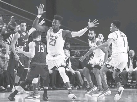 ?? TONI L. SANDYS/THE WASHINGTON POST ?? Maryland's Bruno Fernando finished with eight points and five rebounds despite early foul trouble, and the Terps handled Loyola Chicago.
