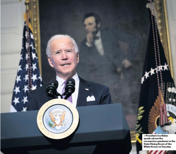 ??  ?? President Joe Biden speaks about the coronaviru­s pandemic in the State Dining Room of the White House on Tuesday