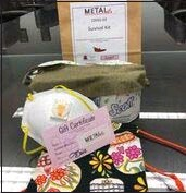 """??  ?? METALfx employees received a """"Survival Kit"""" consisting of a N95 mask, a single-layer mask, triple-layer mask from Adventist Health Howard Memorial Hospital, a gift certificate to a local restaurant, and of course toilet paper."""