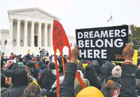 ?? Saul Loeb / AFP / Getty Images 2019 ?? Demonstrators rally at the U.S. Supreme Court in 2019 in support of Deferred Action for Childhood Arrivals, which has been dealt a blow by a federal judge.