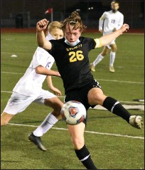 ?? JASON SCHMITT — FOR MEDIANEWS GROUP ?? Clarkston Everest Collegiate senior Anthony Felix gets a leg on the ball during his team's 2-0 loss to Adrian Lenawee Christian in a Division 4 state semifinal game Wednesday night at Troy Athens High School.